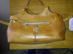 Handbag with stain removal done